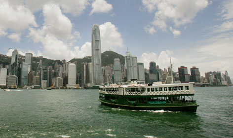 A ferry travels across Hong Kong's Victoria Harbor in 2005. Britain turned over control of the port city to China on July 1, 1997.