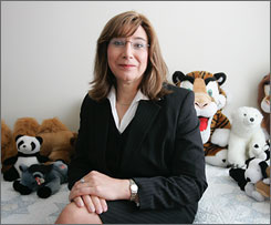 The Justice Department has let pass a deadline to appeal a $500,000 judgment for a Library of Congress job candidate who lost the job while undergoing a sex change. Here, Diane Schroer sits in her apartment in Arlington, Va., in June 2005.