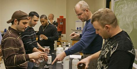 John Schupp, second from right, teaches a class of military veterans in the chemistry lab at Cleveland State University in Cleveland. Schupp runs the university's Supportive Education for the Returning Veteran (SERV) program that allows military veterans to take classes together to help them re-adjust to civilian life.