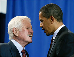 Sen. Ted Kennedy, D-Mass., and Sen. Christopher Dodd, D-Conn., have written a letter outlining a proposal to include a government-run insurance option in President Obama's health-care overhaul plan. Here, Kennedy, left, chats with Obama in April at a school in Washington before the signing of another bill.