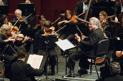 Itzhak Perlman, right, makes his debut with the Westchester Philharmonic during this Oct. 11, 2008, performance.