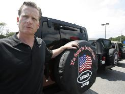 Jim Tarbox, a Chrysler dealership owner who is appealing the company's decision to shutter his franchises, is seen here at one of his dealerships in North Kingstown, R.I.