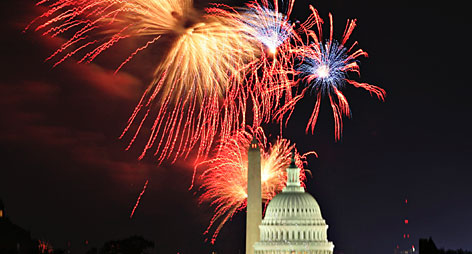 Fireworks explode over the United States Capitol dome and Washington Monument on Independence Day in Washington on  Saturday.