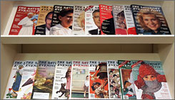 A collection of copies of the Saturday Evening Post are on display in its publications offices in Indianapolis. The nation's oldest magazine is changing its look and its approach to broaden its appeal beyond its mostly older readers.
