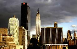 The Empire State Building, center, is shown in this Oct. 29, 2008, photo. To attract more tenants, the real estate group that owns the skyscraper has spent more than $120 million in environmental upgrades.