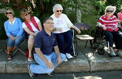 Sen.-elect Al Franken visits Eveleth, Minn., residents during the city's parade Saturday. He also attended the Nashwauk, Keewatin, and Biwabik parades.