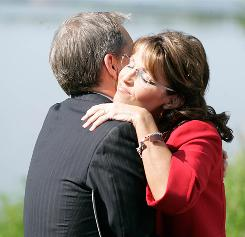 Alaska Gov. Sarah Palin hugs Lt. Gov. Sean Parnell on Friday after she announced stepping down. Parnell will take her seat July 26.