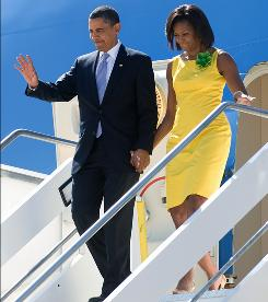 President Obama and first lady Michelle Obama deplane Wednesday in Rome.