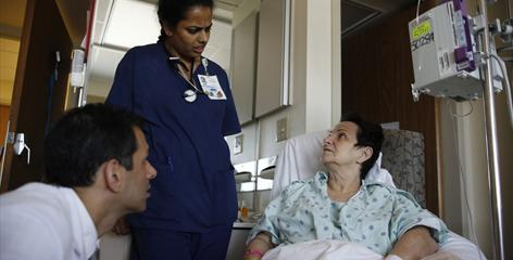 Physician Roger Khetan and nurse Esther Itty talk to patient Gilda Burke, 60, of Keller, Texas, at Baylor Hospital in Dallas. Heart failure patients are in good hands there, where only 15.9% are readmitted within 30 days of discharge, the lowest rate in the country, says a new government analysis.