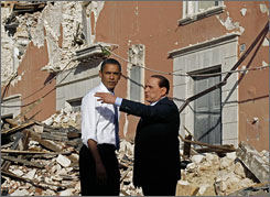 President Obama tours the earthquake-hit Italian town of Onna with Italian Prime Minister Silvio Berlusconi.  More than 50,000 were left homeless in the earthquake.