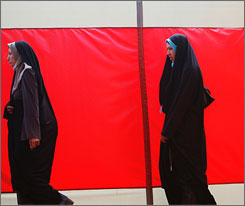 Afghan women arrive for a presidential campaign event in Kabul on June 16.