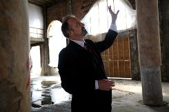 Dan Kildee, who started the Genesee County (Mich.) Land Bank, tours the site of a former hotel being turned into an apartment complex in Flint.