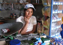 With a drop in funds coming from relatives in the USA, Juliana Resndiz says villagers have stopped buying milk, eggs and meat at her general store in El Epazote, Mexico.