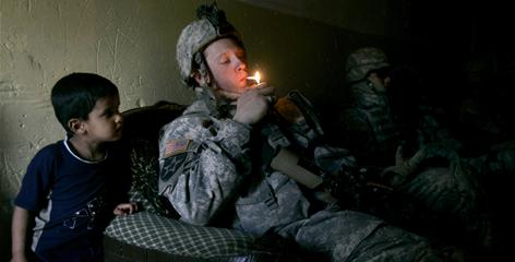 Soldiers from B Company, 1st Battalion, 23rd Infantry Regiment rest after a foot patrol in Baghdad's Shiite enclave of Sadr City. Combat veterans are 50% more likely to use tobacco than troops who haven't seen combat.