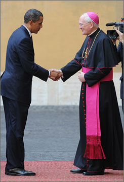 President Obama is welcomed by Bishop James Harvey as he arrives Friday at the Vatican for a meeting with the pope. Obama arrived after wrapping up his participation in the Group of Eight world leaders' summit in L'Aquila, Italy.