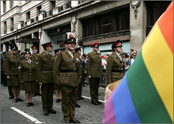 Military personnel march during the annual Pride London parade.