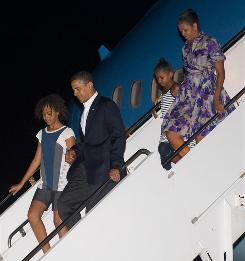 President Obama, first lady Michelle Obama and daughters Malia, left, and Sasha exit Air Force One in Maryland on July 12.