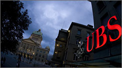 The U.S. brought UBS to court to force the bank, its logo pictured in front of the Swiss Federal Palace in Bern, to reveal the IDs of some 52K Americans suspected of hiding $15B in the bank.