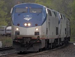 An eastbound train rolls through Amsterdam, N.Y. on April 30.