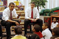 President Obama and Education Secretary Arne Duncan talk to schoolchildren in Chicago in December 2008, when Duncan was the superintendent of Chicago schools.