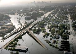 Floodwaters from Hurricane Katrina fill the streets of New Orleans Aug. 30, 2005. Bill Gates has an ambitious plan to prevent or lessen this type of damage by using barges to pump cold water from deep in the ocean to lower the surface temperature of the water in a hurricane's path, thus slowing down the destructive winds produced by the storms.
