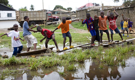 Children play June 15 in the Liberian capital, Monrovia.  Civil wars that began in 1989 claimed the lives of more than 200,000 Liberians before a peace deal ended them in 2003.