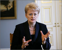 Lithuania's new law blocking information about gays and lesbians to minors will become official once it is signed by President Dalia Grybauskaite, seen here speaking to reporters on Monday in Vilnius, the capital.