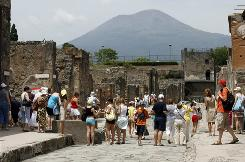 Millions of trampling visitors each year, combined with exposure to sunlight and rain, are a menace to the ancient ruins of Pompeii, one of the world's most famous archaeological sites and Italy's top tourist attraction.