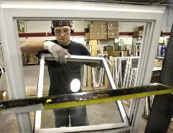 Wallside Windows assemblyman Sam Bernat puts together a window at the window factory in Taylor, Mich.