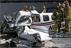 Los Angeles County Firefighters work the scene of a fatal plane crash in Hawthorne, Calif. Wednesday.