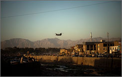 A U.S. military helicopter flies over Kabul, Afghanistan, on Wednesday.
