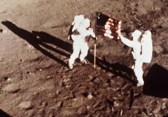 "In this July 20, 1969, file photo, Apollo 11 astronauts Neil Armstrong and Edwin E. ""Buzz"" Aldrin, the first men to walk on the moon, plant the U.S. flag."