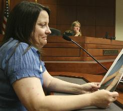 Sally Sturgeon, a forensic nurse, practices testifying during a mock trial in a Louisville courtoom. This is part of the training to be certified to perform forensic exams beyond those for sexual assaults.