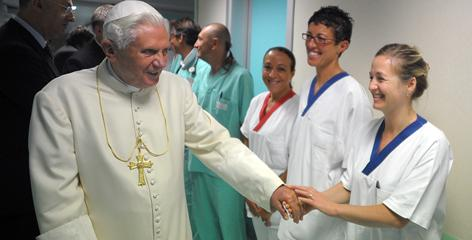 Pope Benedict XVI shakes hands with the medical team of Aosta's Umberto Parini hospital who took care of him July 17. A cast can be seen on his wrist at left.