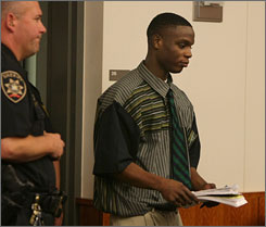 Dwight DeLee enters a courtroom at the Onondaga County Courthouse in Syracuse, N.Y., on Wednesday. DeLee has been convicted of a hate crime in the November slaying of Lateisha Green, a transgendered woman.