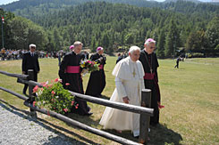 Pope Benedict XVI, second from right, arrives in Les Combes, an Italian Alpine resort in the northern Italian region of Val d'Aosta on Monday.