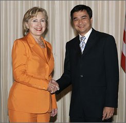 Secretary of State Hillary Rodham Clinton shakes hands with Thailand's Prime Minister Abhisit Vejjajiva at Government House in Bangkok.