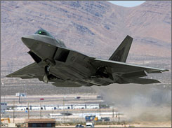 An Air Force F-22 Raptor takes off from Nellis Air Force Base for a military exercise in 2006.