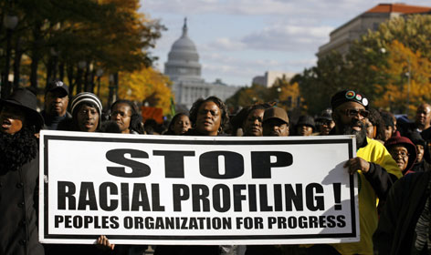 Thousands of people march outside the Justice Department in Washington, D.C., in November 2007. No national system tracks allegations of racial profiling.