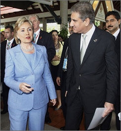Secretary of State Hillary Rodham Clinton talks with Pakistan's Minister of Foreign Affairs Makhdoom Shah Mahmood Qureshi just prior to a bilateral meeting Thursday in Phuket, Thailand.