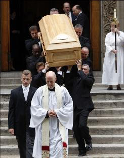 Pallbearers carry the casket of longtime CBS News anchor Walter Cronkite from St. Bartholomew's Church after his funeral service in New York.