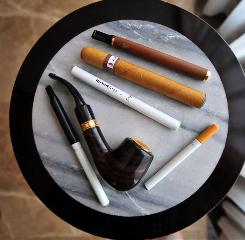 The electronic cigarette and other battery-powered devices are designed to provide the physical sensation and flavors similar to inhaled tobacco smoke.