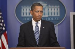 President Obama pauses as he speaks about the incident with Henry Louis Gates and a Cambridge police officer, Friday, July 24, 2009, in the White House pressroom in Washington.