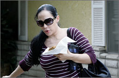 Nadya Suleman, seen here in March, has signed agreements for each of her 14 children to earn $250 a day to star in a reality television show according to court documents.