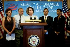 House Speaker Nancy Pelosi, D-Calif., speaks at a news conference on health care changes with House Democrats and patients affected by a lack of health care Wednesday in Washington.