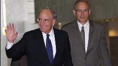 Middle East envoy George Mitchell, left, waves as he arrives at al-Shaab palace in Damascus on Sunday.