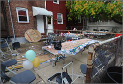 A gunman opened fire in this backyard in Baltimore on Sunday during a cookout and wounded 12 people, police said.
