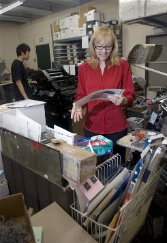 Debi Halcro, president of Valenti Print Group, in the company's main printing area, in Honolulu. Halcro has 43 employees but limits the hours of her three part-time workers so she  doesn't have to pay for their health insurance.