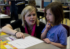 Michelle Trahey talks to first grader Julia Neumann during class. Trahey volunteered at Gray's Woods Elementary School in Port Matilda, Pa. earlier in the year.