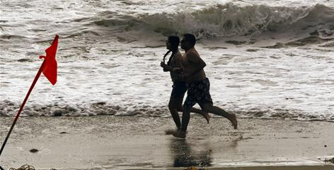 Beachgoers run along the water in Redondo Beach, Calif., on June 22. The Environmental Protection Agency is proposing to spend $36 million to clean up a giant DDT deposit in the ocean off Los Angeles, according to a June report. Montrose Chemical Corp. released 110 tons of the banned pesticide into the sewers from 1947 through 1971. The chemicals then flowed into the ocean off the Palos Verdes Peninsula.